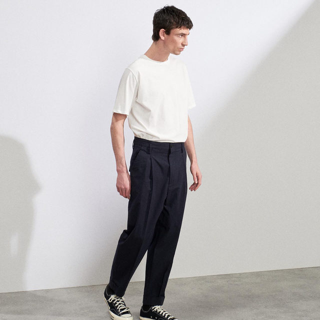 Do you have a daily uniform?  Oversized cotton T-shirt and exaggerated tapered-leg cotton chinos.  Link in bio. #Raey