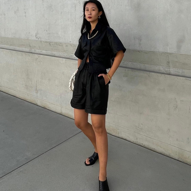@thecarolinelin dressed for a much-needed staycation in Arie Leather Top and Rolled Leather Short in Noir