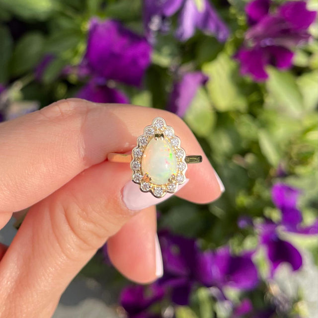 Regal refractions of vibrant colors, this pear-shaped natural Neopolitan Opal center, haloed by irresistible Nude Diamonds Fashioned in Honey Gold is exclusively available at @jaredthegalleriaofjewelry #LeVianColors  Featuring Style TRLM 21
