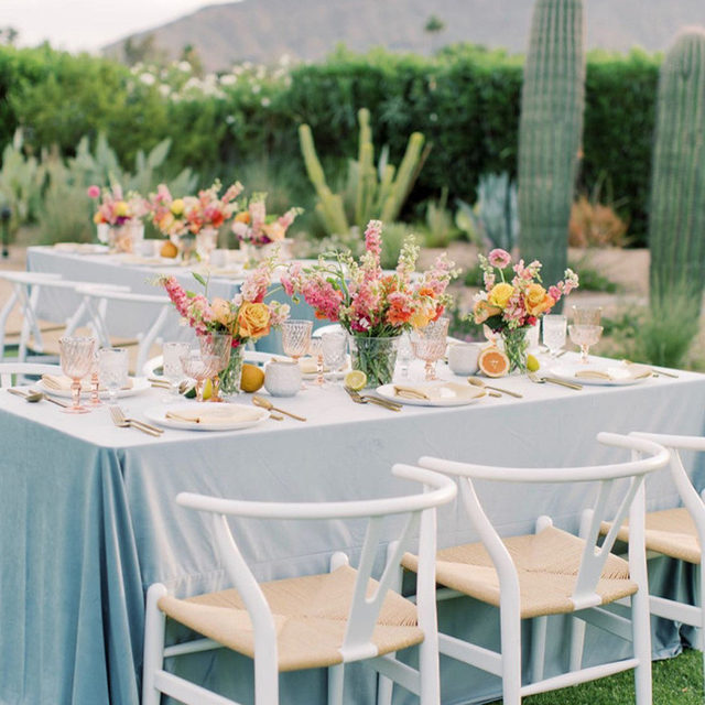 Maybe it's the delectable sorbet color scheme, or maybe it's the citrus accents, or maybe it's seeing our velvet in the desert, either way, we are head over heels in love with this tablescape! 🍊🍋🍈 Featuring our Cadet Blue Velvet Table Linen and Bisque Faille Napkin. Use the link in our bio to plan your own colorful desert oasis.  _________ Credits: Planner: @konsideritdone Photographer: @pinkertonphoto Florist: @sarahsgardenstyle Custom Pieces & Build Outs: @thedetailsduo Rentals: @primrentals, @theconfettistudio Venue: @andazscottsdale