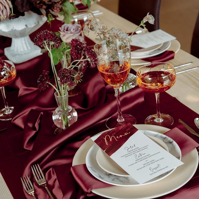 Glamourous and gorgeous, this striking tablescape has us seeing red for all the right reasons! ♥️ A rich and luxurious color, this image has us memorized and we simply cannot get enough. Featuring our Burgundy Lamour Runner and Napkin. Use the link in our bio to start planning your next event with these stunning linen.  _________ Credits: Planners: @flawlessweddingsevents Photography: @gildedphoto Floral: @princessfallar + @flowersbyladybuggs Rentals: @collective_rentals Paper Goods: @monicalewis.art + @erikaseleganceWedding Venue: @secondspaceoc