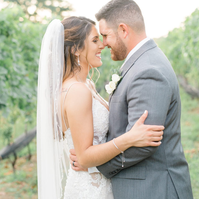 The way Chris looks at Taylor seriously gives us butterflies! 🦋 How cute are they?! 😍・Taylor wore a gorgeous @martinthornburg #weddingdress on her big day! 🤍 If you would like to shop #MartinThornburg's latest collections, you can make an appointment for our @martinthornburg trunk show at our Carle Place salon running until this Sunday; we still have some appointments available Thursday - Sunday. 🥂 To make your appointment, you can click the link in our bio, send us a DM for more information or call our salon at 516-742-7788 👰・Please see below for the vendors of their beautiful outdoors wedding! 🌞  👰🤵 #BridalReflectionsBride @taylorverdino_ @verdi_chr 👰 Dress: @martinthornburg #BridalReflections 📔 Planner: @lessingsweddings 📸 Photography: @jenniferlamphoto 🏰 Venue: @thevineyards_li 📽️ Cinematography: @wecinema 💇♀️ Hair: @updosbylisa 💄 Makeup: @tatiana_angel 💐Floral Design: @villagefloristrocks 👗 Bridesmaids Dresses: @davidsbridal 🤵 Groom & Groomsmen Attire: @menswearhouse 📝 Invitations: @vistaprint 🎂 Cake: @