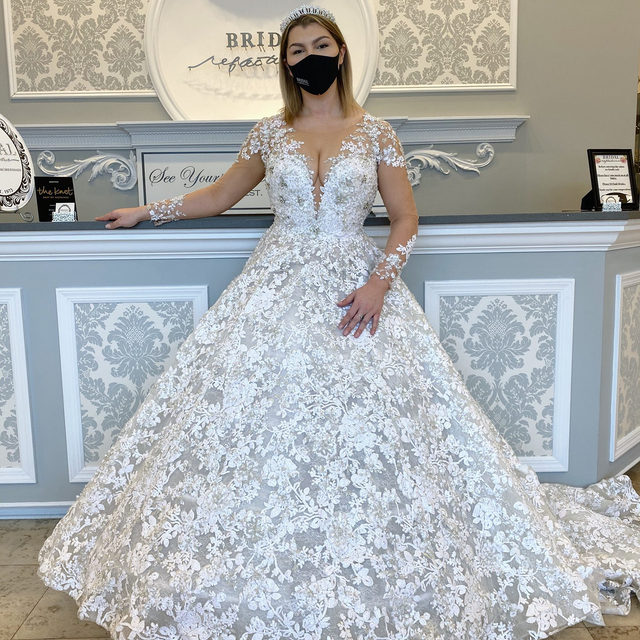 Our queen at the #BridalReflections castle 🏰 😉・This @ysamakino #ballgown is the perfect dress for anyone who would like to resemble a princess on their big day! 👑・Our #YsaMakino trunk show is coming up from April 15-17 at our Carle Place salon! We're so excited to see the gorgeous gowns @leighjprice sends us for this event! To make your appointment, click the link in our bio, send us a DM or call our salon directly at 516-742-7788! ✨ Our very own Sabrina is modeling #YsaMakino style 69142 and accessorized with a crown from @boutiquedevoile! ❤️