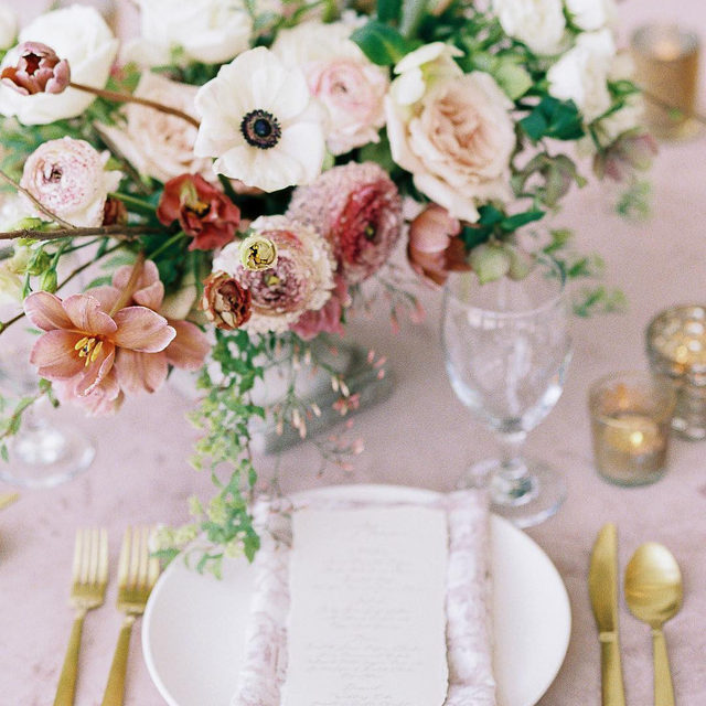 Still one of the most popular color choices for weddings, Blush can effortlessly create a delicate, romantic ambiance. 🌸 Instantly transforming any event into a breathtaking affair. Featuring our Rose Quartz Velvet Table Linen and Rouge Ezra Napkin, this place setting has us blushing.  _________ Credits: Planner: @shannonroseevents Photographer: @beatboxportraits⠀ Floral: @lushcouturefloral ⠀ Paper: @brownfoxcreative⠀ Venue: @fireflygardens⠀