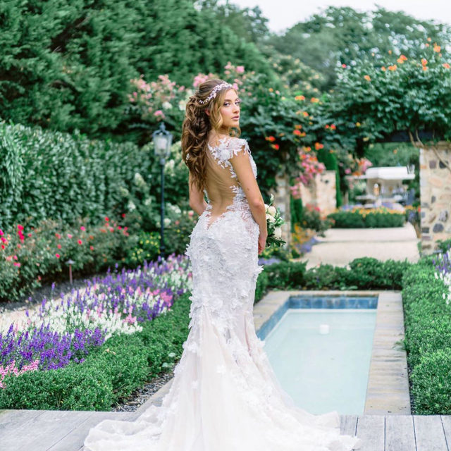 Garden Goddess in #Galia 🌸 (now try saying that 3x fast! 😉) #TBT to our photoshoot at @thelarkfield with @victoriaelizabethofficial, @silentcapturephoto & other incredible vendors! Full list is below 👰・Our @galialahav trunk show is coming up from April 27 - May 2 and May 11 - 16 at our Fifth Avenue salon, we are spreading this event out over two weeks so we are able to accommodate more #BridalReflectionsBrides while maintaining social distancing guidelines! 🤍 To make your appointment, call our salon at 212-764-3040, click the link in our bio to request an appointment or send us a DM for more information! 🥂  👰 dress: #GaliaLahav at #BridalReflections 💇‍♀️💄 @victoriaelizabethofficial 📸 @silentcapturephoto 💎 headpiece @boutiquedevoile 💐 @pedestalsfloraldecorators 🏰 @thelarkfield 🍦 @dolceandgelatocatering