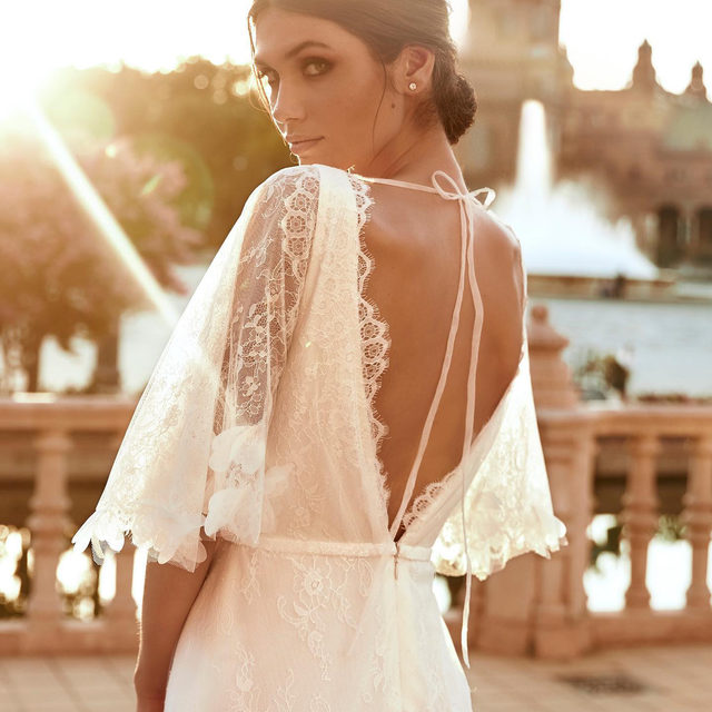 A boho silhouette with hundreds of organza flowers, creating a lush, feathery effect. Meet the Roc dress from the New #MarchesaForPronovias Collection. #Marchesa #Pronovias