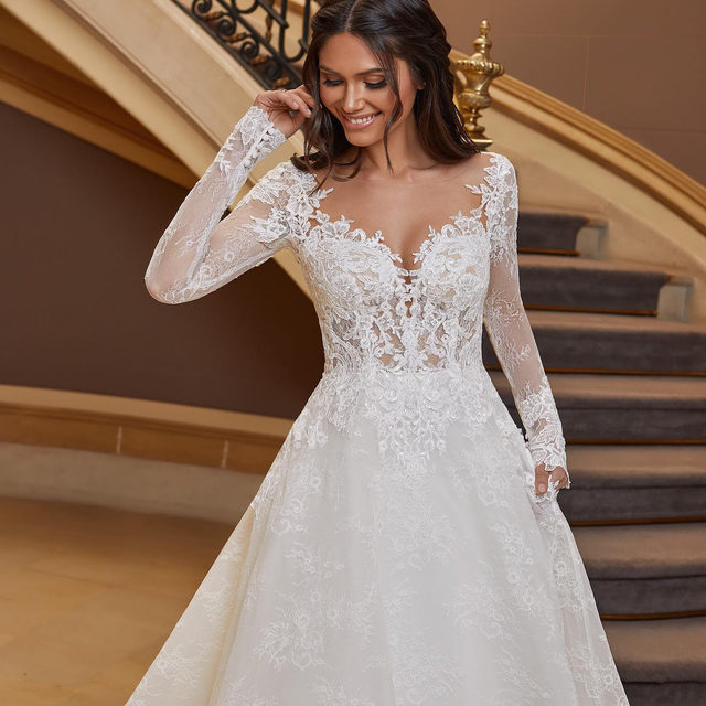 Gorgeous handmade lace, a tattoo-effect bodice and long embroidered sleeves. Meet the ultimate princess style dress at your nearest #Pronovias. Dress: Ginny.