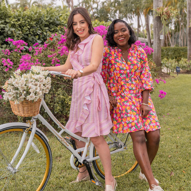 """""""What's not to love about ruffles and pink?"""" says Miami blogger @caroldemauro (left), pictured here with pal @thebstinger. """"I love how comfortable and feminine this dress is. It would make the cutest dress for a walk at the park, going out for coffee with friends, or a bike ride!"""""""