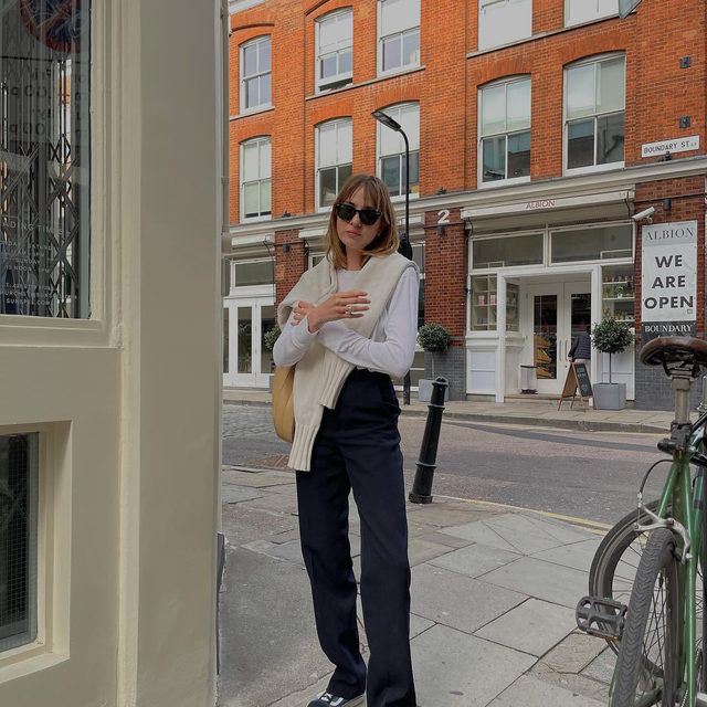 Tuesday strolls 🚶♀️ @shotfromthestreet wearing our high-rise wool tailored trousers #regram