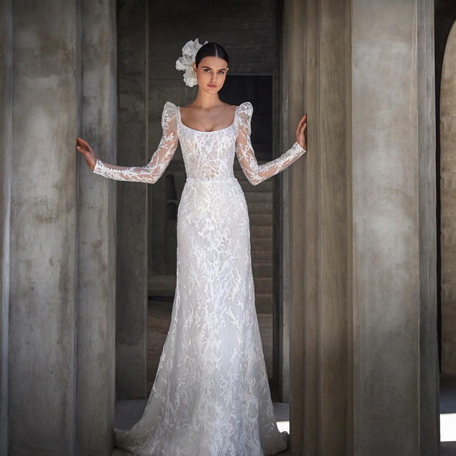 Made of hand-embroidered tulle, with romantic puffed sleeves and a fashionable square back. Meet Clemence from #AtelierPronovias by @alessandrarinaudo. #Pronovias