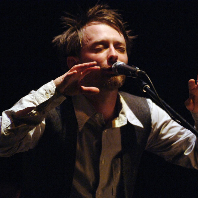 """Last year, producer Nigel Godrich began to unearth footage from his From the Basement series, adding the archival videos to the show's YouTube page. Godrich and @Radiohead have now released a real rarity in the series: @ThomYorke's 2005 solo piano concert that served as the series' pilot episode. His performance includes early versions of In Rainbows' """"Videotape,"""" """"Down Is the New Up,"""" and """"Last Flowers."""" Watch the concert in full at the link in our bio.   📷  by Hayley Madden/Redferns/ Getty Images  #Radiohead #ThomYorke #BasementSeries #Pitchfork"""