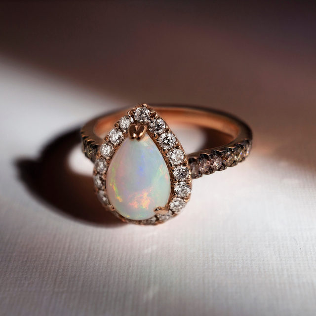 Find your light✨ A brilliant Le Vian Opal ring with Diamonds halo set in 14K Strawberry Gold. Exclusively available at @KayJewelers  Link in bio to shop! #LeVianColors