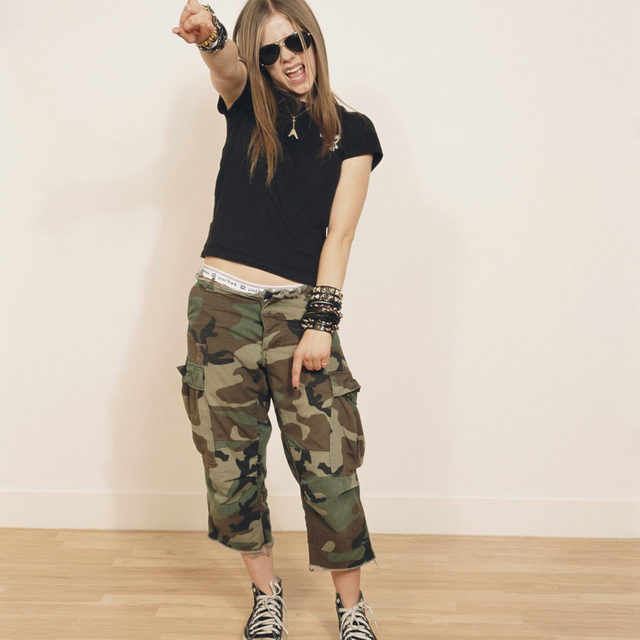 """Ahead of her debut album, Avril Lavigne's label  had her work with production group Matrix. They listened to her early demos and made songs with a Faith Hill vibe that they thought Lavigne would like. That is, until she walked into the studio for the first time with """"melted toothbrushes up her arm, her hair in braids [and wearing] black skater boots."""" They scrapped their work and went back to the drawing board. Lavigne and the Matrix came together the very next day and wrote """"Complicated,"""" the song that made her a teen icon. Read more about the story behind her pop-punk debut, Let Go, at the link in our bio.  📷 by Tim Roney/Getty Images  #SundayReview #AvrilLavigne #PopPunk #LetGo"""