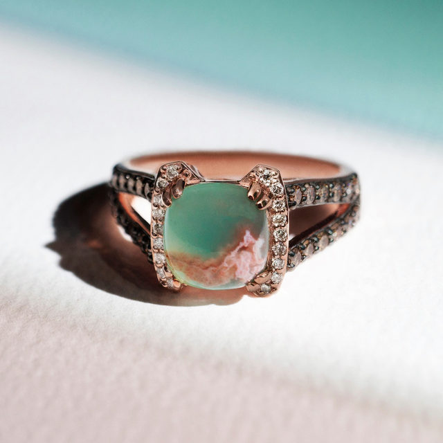 Submerge yourself in a Caribbean blue paradise this summer. This special 14k Strawberry Gold ring features a stunning Aquaprase perched atop lines of nude and chocolate diamonds.  Link in bio to shop the piece! #LeVianColors