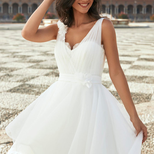 A classic princess silhouette given a fresh twist with an asymmetrical layer on the organza and tulle skirt. Its the Coralle dress from the New #MarchesaForPronovias Collection. Discover more about our in store events where you can be the first to try our latest Collection. Click on the link in bio.