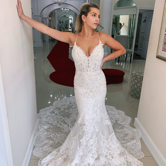 A new arrival at Massapequa, and it is already loved! 💕 So many #brides have asked to see the Nini dress from #EnzoaniBlue, and it has finally arrived! 👰・Our very own Gia was so excited to try this beauty on, and we definitely understand the hype! 🤍 To try the @enzoani Nini dress on, call our Massapequa salon at 516-795-2222, send us a DM or even click the link in our bio! 🥂