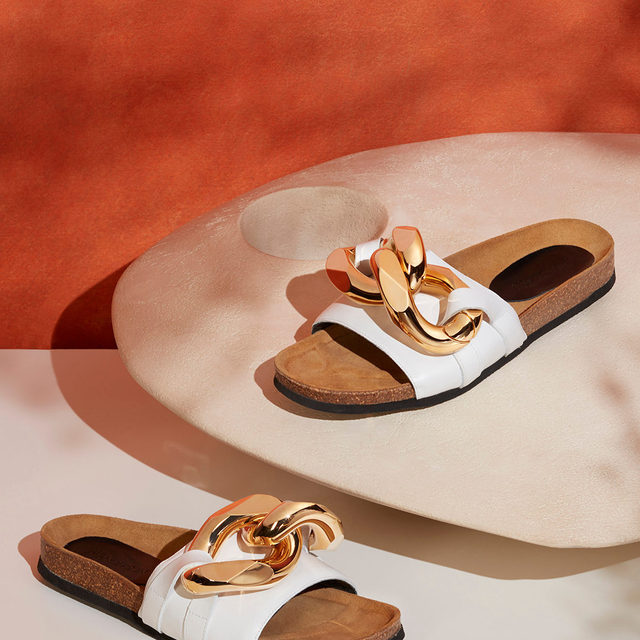 CHAIN REACTION: Topped with the same chunky chains as the coveted slippers, @jw_anderson's slides will earn you major fashion points  Tap the link in bio to shop at #NETAPORTER