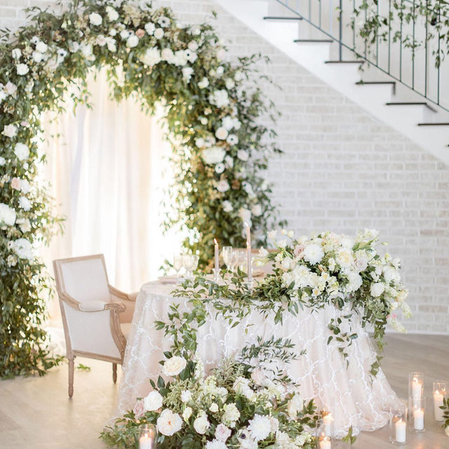 The most romantic sweetheart table.🤍 Opting for this intimate style of seating creates a completely different dynamic for your reception. By splurging on rentals and florals for one table, you have the opportunity to design an awe-inspiring focal point specifically for the newlyweds. Featuring our Silver Grandeur Overlay. Visit the link in our bio to start planning your own sweetheart table.  _________ Credits: Planner: @eventsbyelle Photography: @ashleyicephotos  Florals: @goodearthfloral  Rentals: @ultrapom  Venue: @whiteironridge