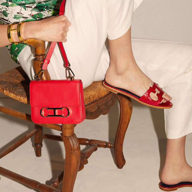 There's a shade of red for every woman. Discover #CHInitialsInsignia bag and #CHInsignia sandals in #CHRed online and #instore