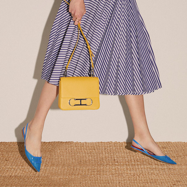 Wearable sunshine. #CHInitialsInsignia and #CHShoeLove add a touch of color to your closet. Visit us online or #instore to discover #CHInsignia