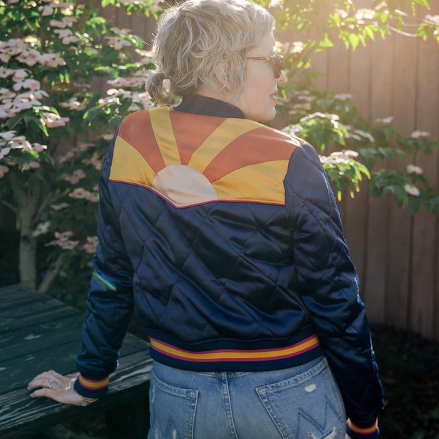 The happiest jacket that ever was...and so rad, too. Love throwing on this retro bomber anytime I need a pick-me-up. Runs small. Wearing a Medium. xo,  Laura @laurajansenstyle . Click the link in our bio to snap up Laura's look. . . . . . #bomberjacket #fashion #fashionblogger #styleblogging #ootd #jeans #tee #etsy #everydaystyle #happy #themomedit #themomeditstyle