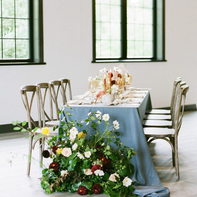 A dreamy tablescape brimming with rustic charm.💙There's nothing quite as magical as bringing the enchantment of the outdoors, indoors and we think this design accomplished just that! Featuring our Slate Faille Table Linen. Use the link in our bio to learn more about this gorgeous linen.  _________ Credits: Planner: @alliey_co Photography: @erinjhanson Florals: @ebbandflowflowers Venue: @theledgecrestreserve