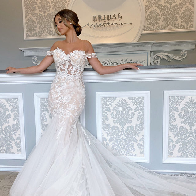 @enzoani's Narine is nothing but a dream 💭🤍・Some #BTS photos from our photoshoot with @li_brushandblush today at our Carle Place salon! How gorgeous is this romantic mermaid #weddingdress? It's definitely a must-try on dress! 🤩 We're so excited to see the footage from @michaeljohn_photography & @opoline! 😍・To try this gown on at our #Enzoani trunk show coming up at our Carle Place salon from 5/21 - 5/23, you can call our salon at 516-742-7788, send us a DM for more information or click the link in our bio! 🥂 See you there! 😉  👰 dress: Narine by @enzoani from #BridalReflections 💇♀️💄 @li_brushandblush 📸 @michaeljohn_photography 📽️ @opoline 👰 Model: @yasmeena.xo
