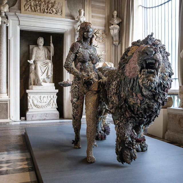 """""""Archaeology Now"""" is now open at the Galleria Borghese in Rome. In this exhibition, more than eighty works from Damien Hirst's """"Treasures from the Wreck of the Unbelievable"""" series are displayed throughout the museum alongside ancient masterpieces from the permanent collection. Hirst's """"Colour Space"""" paintings are also exhibited—for the first time in Italy—among the collection and his colossal sculpture """"Hydra and Kali"""" is presented outdoors in the Giardino Segreto dell'Uccelliera. Follow the link in our bio to learn more. __________ #DamienHirst #ArchaeologyNow #GalleriaBorghese #Gagosian @damienhirst @galleriaborgheseufficiale Artwork © Damien Hirst and Science Ltd. All rights reserved DACS 2021/SIAE 2021. Photos: A. Novelli © Galleria Borghese-Ministero della Cultura"""